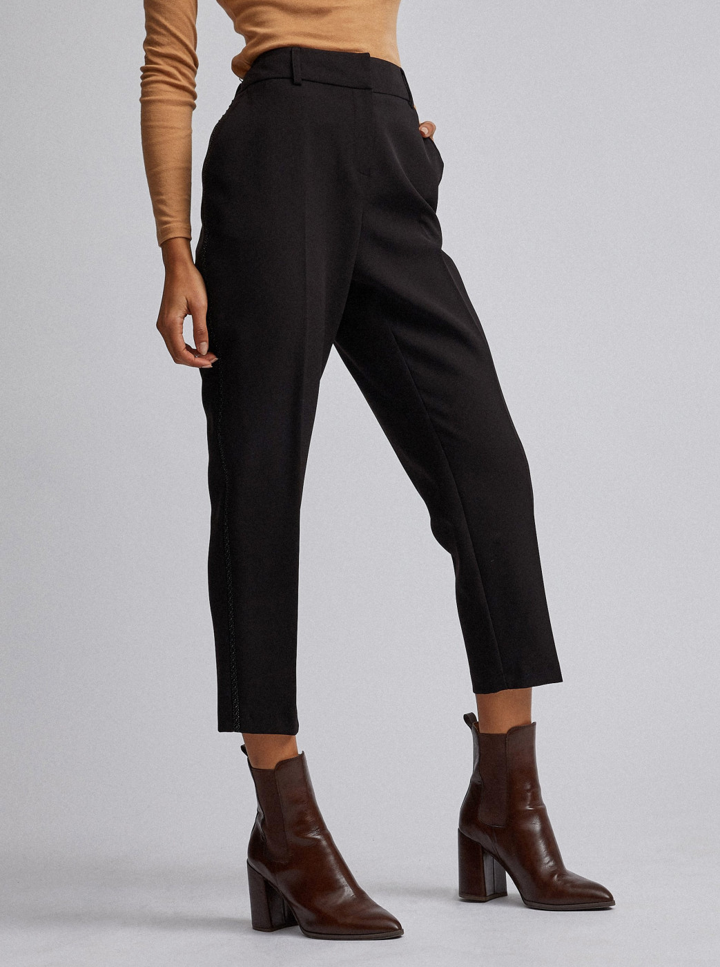 Black cropped trousers with Dorothy Perkins lamp