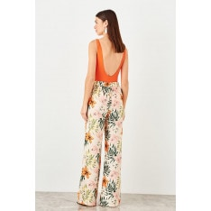 Trendyol Beige Floral patterned trousers