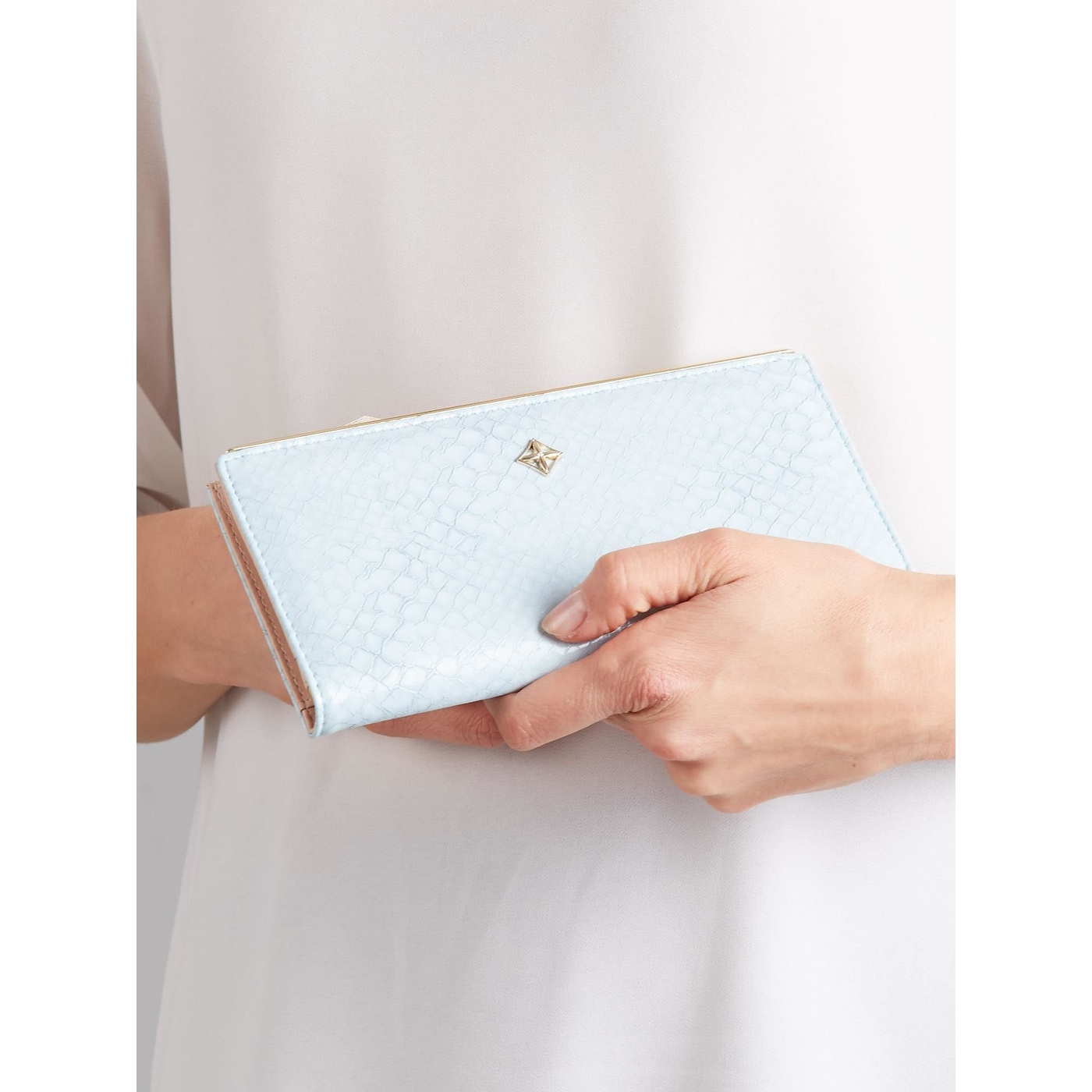 Wallet with a subtle blue pattern