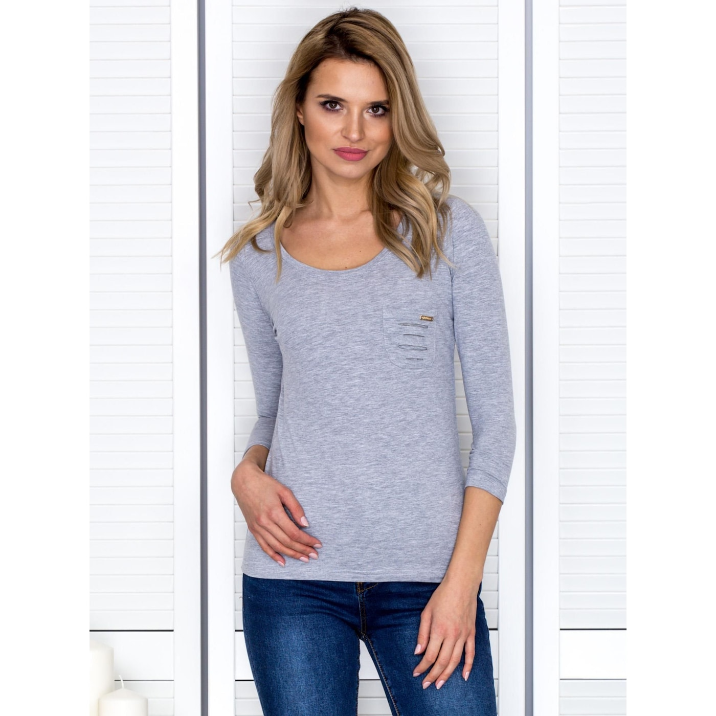 Light gray blouse with cutouts at the back