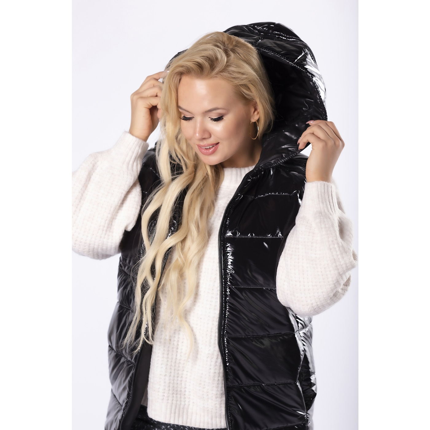quilted vest with a zipper on the hood