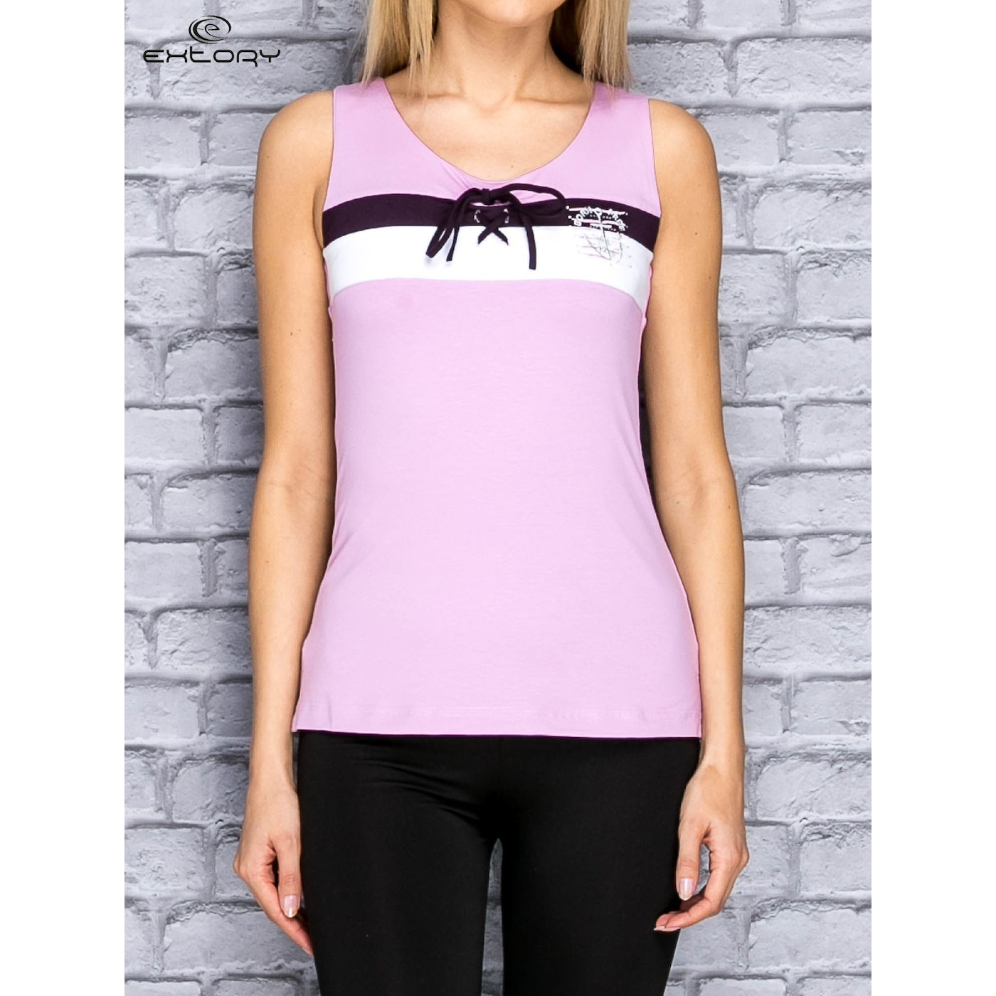A purple sports top with a sailor style binding